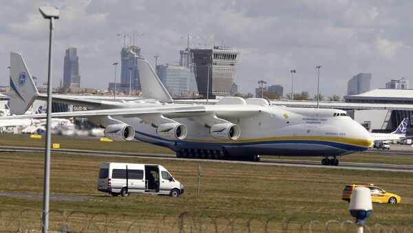 The world's largest cargo plane, the Soviet-made Antonov An-225 Mrija, lands in Warsaw's Frederic Chopin airport with a $15 million worth cargo of protective masks, outfits and visors that were bought by Poland's state-owned companies for hospitals fighting the coronavirus spread, in Warsaw, Poland, Tuesday, April 14, 2020. - Sputnik International