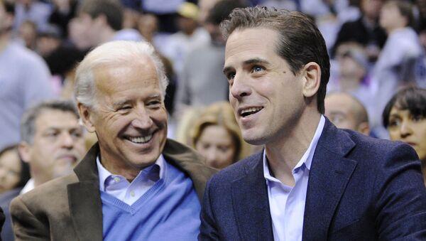 Then Vice President Joe Biden, left, and his son Hunter Biden appear at the Duke Georgetown NCAA college basketball game in Washington on Jan. 30, 2010. - Sputnik International