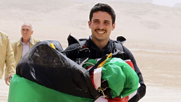 This file photo taken on 17 April 2012 shows Jordanian Prince Hamzah bin al-Hussein, president of the Royal Aero Sports Club of Jordan, with a parachute during a media event to announce the launch of Skydive Jordan, in the Wadi Rum desert.  - Sputnik International