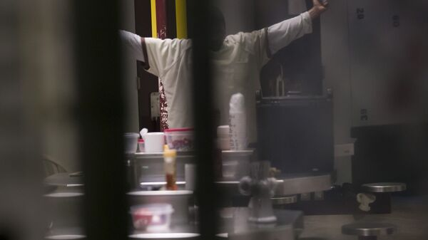 In this photo reviewed by U.S. military officials, a detainee, name and facial identification not permitted, stretches inside the Camp VI detention facility, Wednesday, April 17, 2019, in Guantanamo Bay Naval Base, Cuba. - Sputnik International