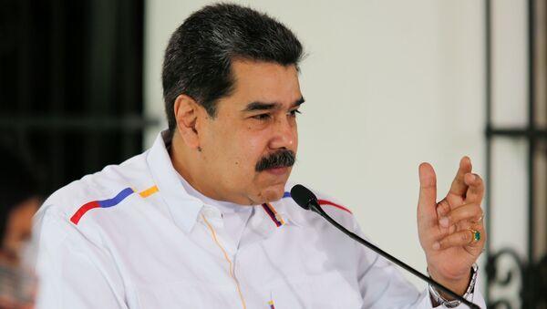Venezuela's President Nicolas Maduro gestures during a state television address, in Caracas, Venezuela March 28, 2021. - Sputnik International