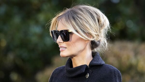 First Lady Melania Trump accompanies President Donald Trump who is speaking to reporters on the South Lawn of the White House, Wednesday, 20 January 2021, in Washington, DC. - Sputnik International