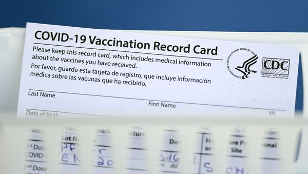 A vaccination record card is shown during a COVID-19 vaccination drive for Spring Branch Independent School District education workers Tuesday, March 16, 2021, in Houston. - Sputnik International