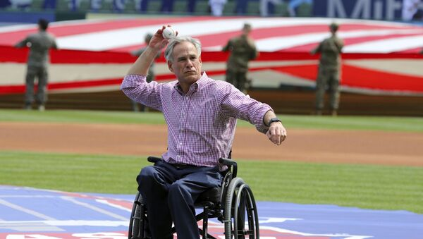 Texas Governor Greg Abbott throws out the ceremonial first pitch at the opening day baseball game between the Chicago Cubs and Texas Rangers Thursday, March 28, 2019 in Arlington, Texas.  - Sputnik International
