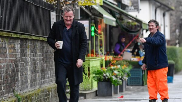 A passerby gestures to journalist and television presenter Piers Morgan, after he left his high-profile breakfast slot with the broadcaster ITV, following his long-running criticism of Prince Harry's wife Meghan, in London, Britain, 10 March 2021 - Sputnik International