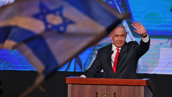 In this file photo taken on March 24, 2021, Israeli Prime Minister Benjamin Netanyahu, leader of the Likud party, addresses supporters at the party campaign headquarters in Jerusalem after the end of voting in the fourth national election in two years. - Sputnik International
