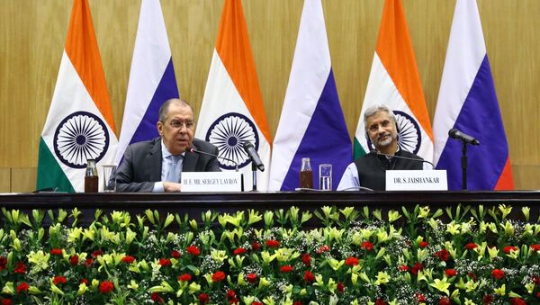 Russian Foreign Minister Sergei Lavrov, left, and his Indian counterpart Subrahmanyam Jaishankar attend a joint news conference following their meeting, in New Delhi, India - Sputnik International