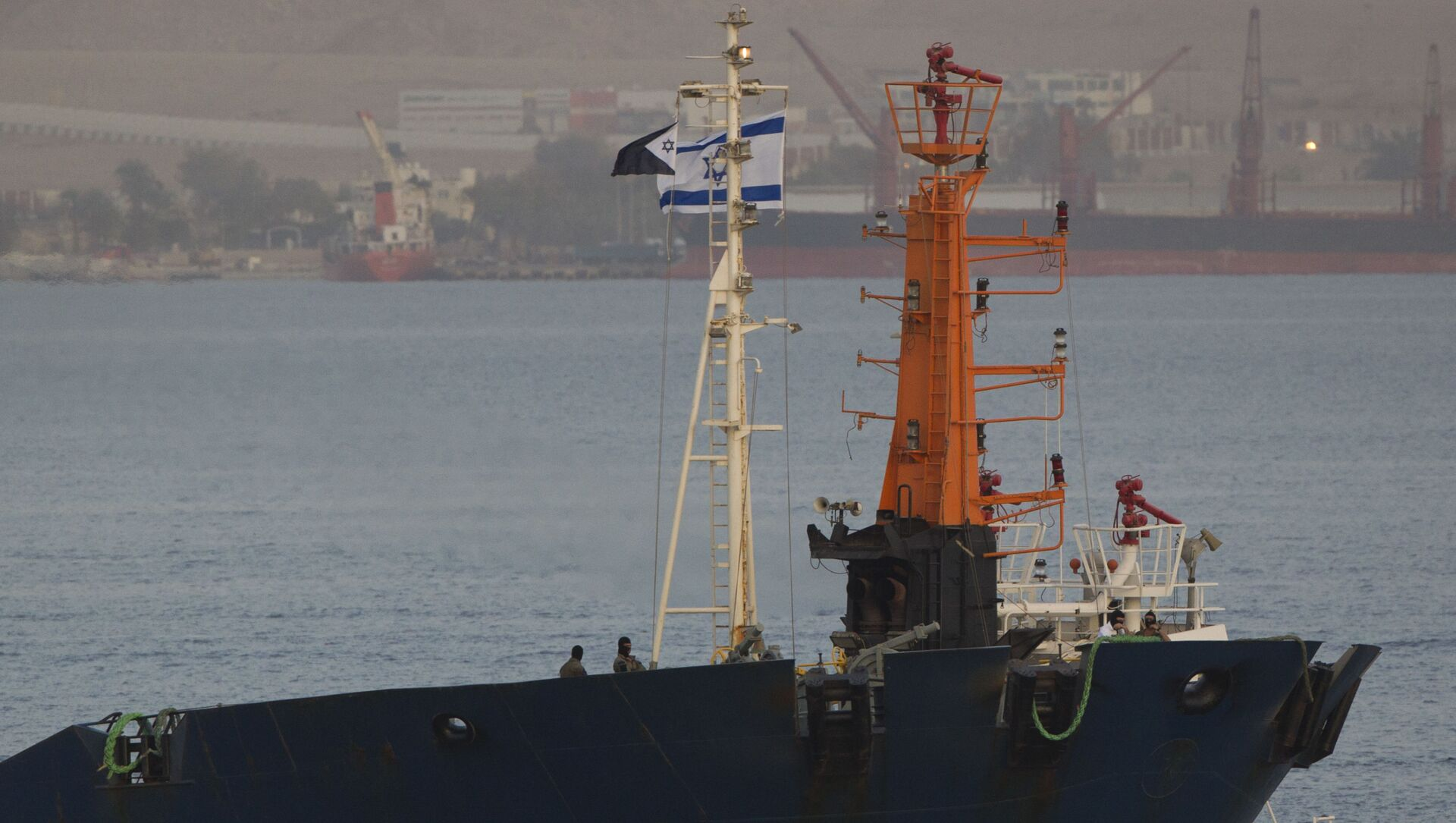 Israeli commandos stand guard on the seized KLOS-C cargo ship as it enters the port, at the Red Sea resort city of Eilat, southern Israel, Saturday, March 8, 2014. Israeli naval forces raided the ship hundreds of miles from Israel, in the Red Sea on Wednesday and seized dozens of advanced rockets from Iran destined for Palestinian militants in Gaza, according to the Israeli military. The Islamic Jihad, an Iranian-backed militant group in the Gaza Strip says it is not involved in a seized missile shipment. - Sputnik International, 1920, 07.04.2021