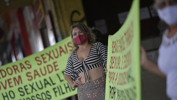 Sex workers protest at Rua Guaicurus, the main bohemian area of Belo Horizonte, in the state of Minas Gerais, Brazil on 5 April 2021, asking to be considered a priority group to receive the vaccine against COVID-19 - Sputnik International