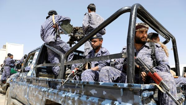 Police troopers ride on the back of a patrol truck following a funeral of Houthi fighters killed during recent fighting against government forces at different fronts, in Sanaa, Yemen March 23, 2021 - Sputnik International
