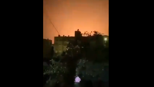 Screenshot from a video allegedly showing explosions lighting up the sky above Damascus area after what was described as Israeli aggression - Sputnik International