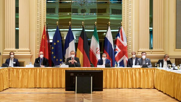 In this Handout photo made available by the EU delegation in Vienna shows  Diplomats of the EU, China, Russia and Iran at the start of talks at the Grand Hotel in Vienna on April 6, 2021. - The US will participate in discussions in Vienna to try to save the international agreement on Iranian nuclear power. However, they will not be at the same table as Tehran and it is the Europeans who will serve as intermediaries between the two parties, in the hope of achieving concrete results after two months of impasse.  - Sputnik International
