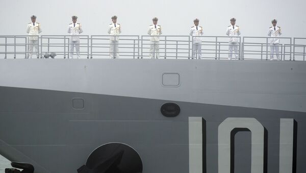 Sailors stand on the deck of the new type 055 guided-missile destroyer Nanchang of the Chinese People's Liberation Army (PLA) Navy as it participates in a naval parade to commemorate the 70th anniversary of the founding of China's PLA Navy in the sea near Qingdao in eastern China's Shandong province, Tuesday, 23 April 2019 - Sputnik International