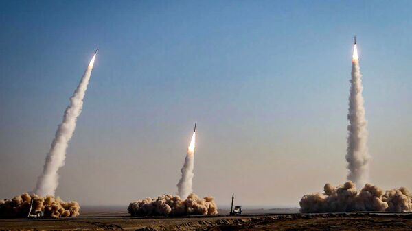 This handout photo provided by Iran's Revolutionary Guard Corps (IRGC) official website via SEPAH News on January 15, 2021, shows a launch of missiles during a military drill in an unknown location in central Iran - Sputnik International