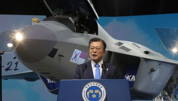 South Korean President Moon Jae-in delivers his speech in front of a prototype of the country's first homegrown fighter jet called KF-21 during its rollout ceremony in Sacheon, South Korea, April 9, 2021. - Sputnik International