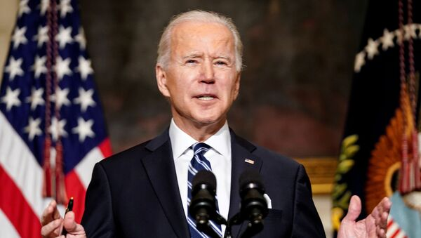 FILE PHOTO: U.S. President Joe Biden delivers remarks on tackling climate change prior to signing executive actions in the State Dining Room at the White House in Washington, U.S., January 27, 2021.  - Sputnik International