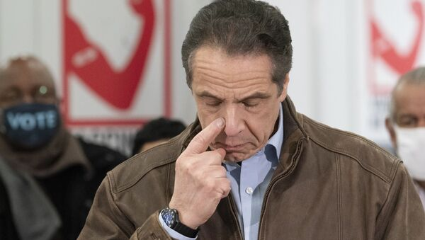 New York Gov. Andrew Cuomo touches his nose during a visit to a new COVID-19 vaccination site, Monday, March 15, 2021, at the State University of New York in Old Westbury. The site is scheduled to open on Friday.  - Sputnik International