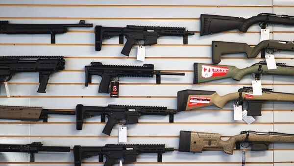 """DELRAY BEACH, FLORIDA - MARCH 24: Weapons for sale hang on the wall at WEX Gunworks on March 24, 2021 in Delray Beach, Florida. U.S. President Joe Biden has called on lawmakers to """"immediately pass"""" legislation to help curb gun violence in the county.   - Sputnik International"""