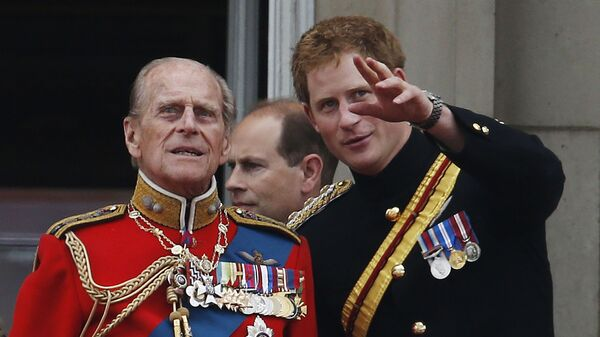 In this June 14, 2014 file photo, Britain's Prince Harry talks to Prince Philip as members of the Royal family appear on the balcony of Buckingham Palace, during the Trooping The Colour parade, in central London - Sputnik International
