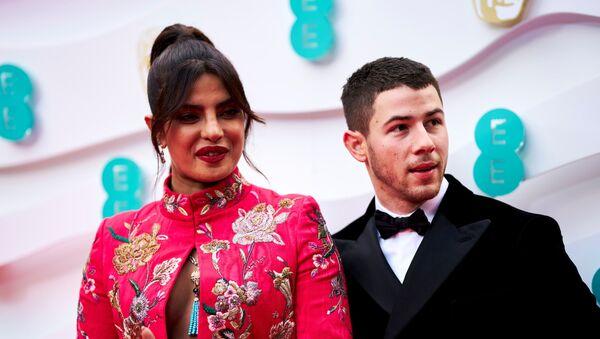 Priyanka Chopra Jonas and Nick Jonas attend the 74th British Academy Film Awards in London, Britain, April 11, 2021 - Sputnik International