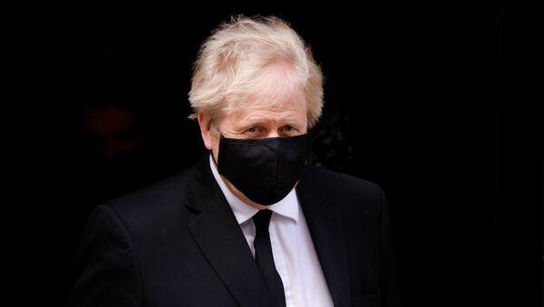 Britain's Prime Minister Boris Johnson leaves Downing Street in London, Britain, April 12, 2021 - Sputnik International