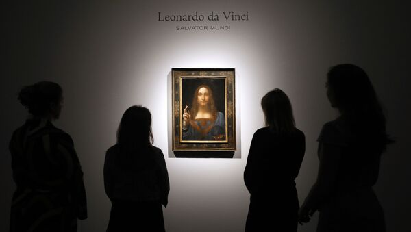 In this Oct. 24, 2017, file photo, people gather around Leonardo da Vinci's Salvator Mundi on display at Christie's auction rooms in London.  - Sputnik International