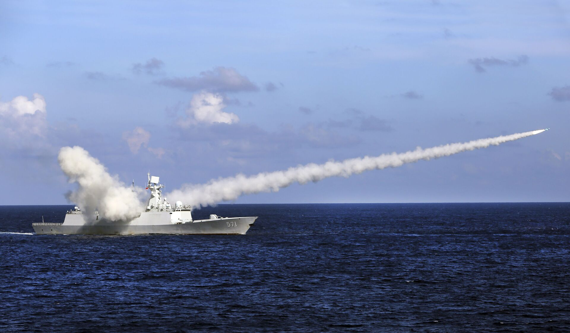 In this Friday, July 8, 2016, file photo released by Xinhua News Agency, Chinese missile frigate Yuncheng launches an anti-ship missile during a military exercise in the waters near south China's Hainan Island and Paracel Islands. China is holding another round of military drills in the South China Sea amid an uptick in such activity in the area highlighting growing tensions - Sputnik International, 1920, 07.09.2021