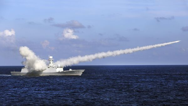 In this Friday, July 8, 2016, file photo released by Xinhua News Agency, Chinese missile frigate Yuncheng launches an anti-ship missile during a military exercise in the waters near south China's Hainan Island and Paracel Islands. China is holding another round of military drills in the South China Sea amid an uptick in such activity in the area highlighting growing tensions - Sputnik International