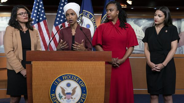 From left, U.S. Reps. Rashida Tlaib, D-Mich., Ilhan Omar, D-Minn., Ayanna Pressley, D-Mass., and Alexandria Ocasio-Cortez, D-N.Y., respond to base remarks by President Donald Trump after he called for four Democratic congresswomen of color to go back to their broken countries, as he exploited the nation's glaring racial divisions once again for political gain, during a news conference at the Capitol in Washington, Monday, July 15, 2019 - Sputnik International