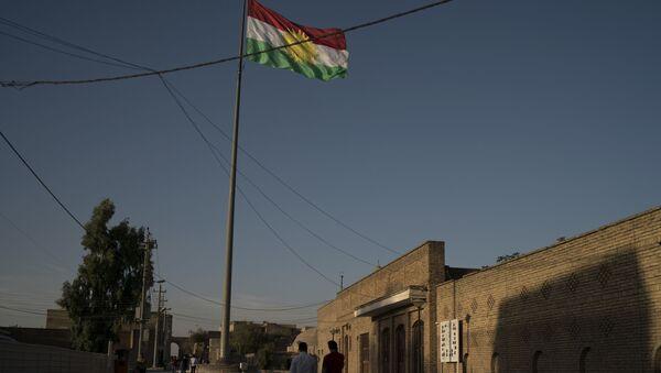 A Kurdish flag waves inside the Irbil's citadel in central Irbil, Iraq, Saturday, Oct. 21, 2017. - Sputnik International