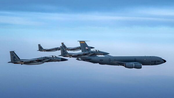 A handout picture provided by the Saudi Ministry of Defence on June 16, 2019 shows Saudi F-15 Eagles flying in formation with their US Air Force counterparts and a USAF KC-135 Stratotanker jet (R) in the US CENTCOM area of responsibility, on June 2. - Sputnik International