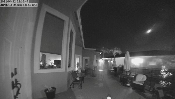 A meteor is seen moving across Florida sky, in Parkland, Florida, U.S., April 12, 2021 in this still image obtained from a social media video. - Sputnik International