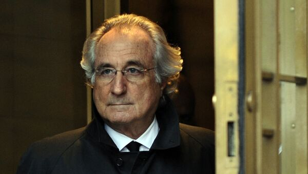 In this file photo Bernard Madoff leaves US Federal Court after a hearing regarding his bail on January 14, 2009 in New York. - Sputnik International