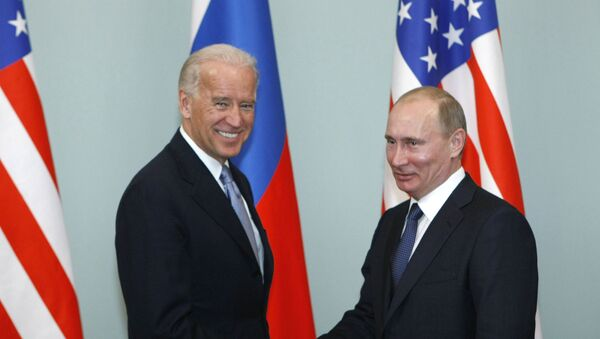 In this March 10, 2011, file photo, Vice President of the United States Joe Biden, left, shakes hands with Russian Prime Minister Vladimir Putin in Moscow, Russia. - Sputnik International