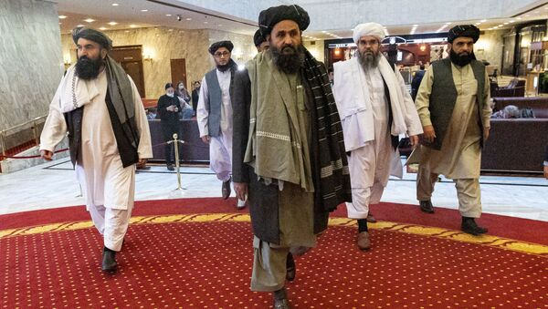 Mullah Abdul Ghani Baradar, the Taliban's deputy leader and negotiator, and other delegation members attend the Afghan peace conference in Moscow, Russia, 18 March 2021. - Sputnik International