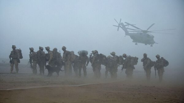In this file photo, US Marines from the 2nd Battalion, 8th Marine Regiment of the 2nd Marine Expeditionary Brigade wait for helicopter transport as part of Operation Khanjar at Camp Dwyer in Helmand Province in Afghanistan on 2 July 2009. - Sputnik International