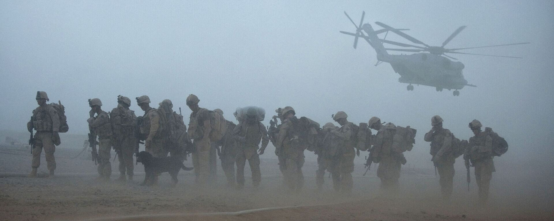 In this file photo US Marines from the 2nd Battalion, 8th Marine Regiment of the 2nd Marine Expeditionary Brigade wait for helicopter transport as part of Operation Khanjar at Camp Dwyer in Helmand Province in Afghanistan on July 2, 2009. - Sputnik International, 1920