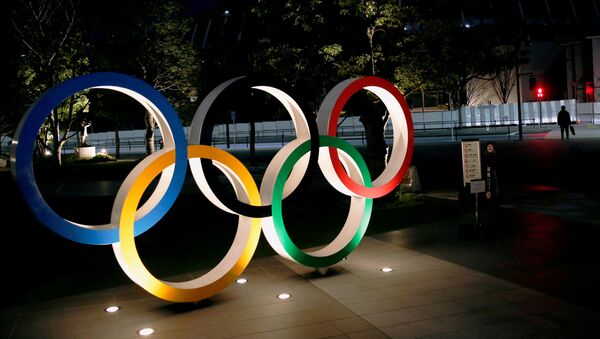 The Olympic rings are illuminated in front of the National Stadium in Tokyo, Japan January 22, 2021. - Sputnik International