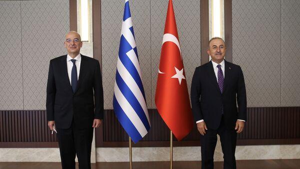 Turkish Foreign Minister Mevlut Cavusoglu meets with his Greek counterpart Nikos Dendias in Ankara, Turkey April 15, 2021. - Sputnik International
