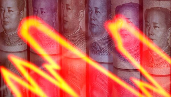Chinese yuan banknotes are seen behind illuminated stock graph in this illustration taken February 10, 2020 - Sputnik International