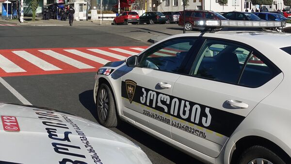 Police cars block the road in front of the Bank of Georgia, in the city of Zugdidi, Georgia. An armed man took 19 persons, including bank staff members and customers, under hostage in the afternoon of October 21 - Sputnik International