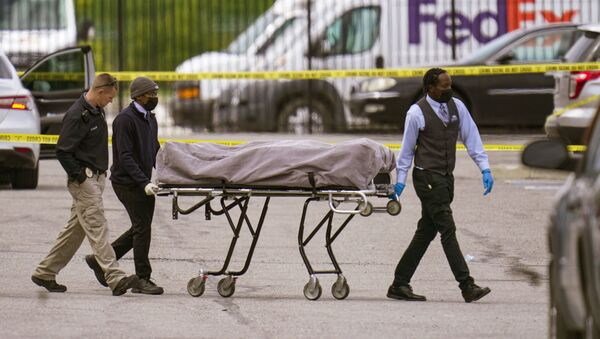 A body is taken from the scene where multiple people were shot at a FedEx Ground facility in Indianapolis, Friday, April 16, 2021. A gunman killed several people and wounded others before taking his own life in a late-night attack at a FedEx facility near the Indianapolis airport, police said. - Sputnik International