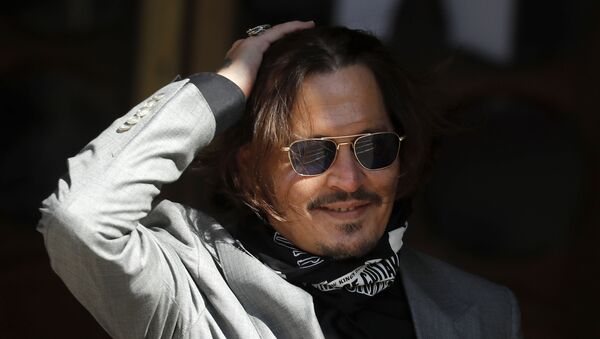 In this file photo dated Tuesday, July 28, 2020, US Actor Johnny Depp arrives at the High Court in London during his case against News Group Newspapers over a story published about his former wife Amber Heard, which branded him a 'wife beater' - Sputnik International