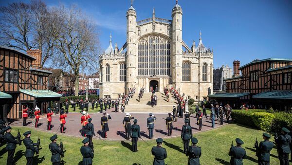 The coffin of Britain's Prince Philip, husband of Queen Elizabeth, who died at the age of 99, is taken into St. George's Chapel for a funeral service, in Windsor, Britain, April 17, 2021.  - Sputnik International