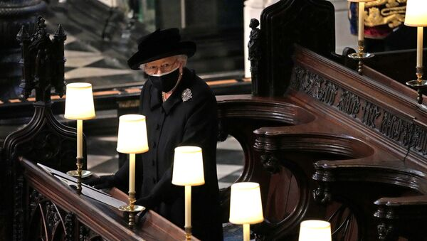 Britain's Queen Elizabeth is seen during the funeral of Britain's Prince Philip, husband of Queen Elizabeth, who died at the age of 99, at St George's Chapel, in Windsor, Britain, April 17, 2021. Yui Mok/Pool via REUTERS     TPX IMAGES OF THE DAY - Sputnik International
