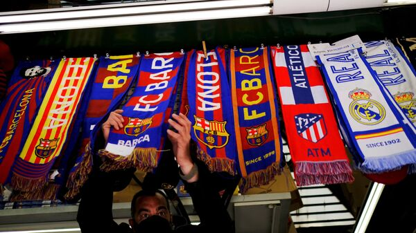 Soccer Football - FC Barcelona, Atletico Madrid and Real Madrid scarves are displayed inside a store at Las Ramblas as twelve of Europe's top football clubs launch a breakaway Super League - Barcelona, Spain - April 19, 2021 - Sputnik International