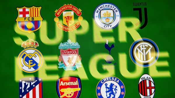 Super League words are seen in front of twelve of Europe's top football clubs logos in this illustration taken April 19, 2021 - Sputnik International