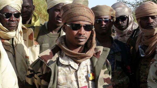 The son of Chad's late president Idriss Deby, Mahamat Idriss Deby Itno (also known as Mahamat Kaka) and Chadian army officers gather in the northeastern town of Kidal, Mali, February 7, 2013 - Sputnik International