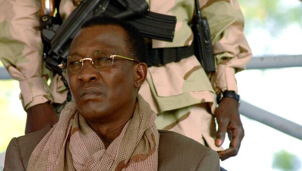 FILE PHOTO: Chad President Idriss Deby watches a rally in N'Djamena April 15, 2006. Deby's supporters paraded victoriously through the streets of the capital N'Djamena on Saturday but many nervous residents feared rebels fighting to topple him may return.  - Sputnik International