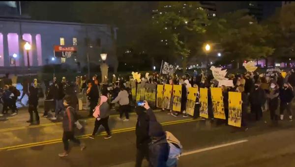 A screenshot from footage of demonstrators marching in Columbus, Ohio. - Sputnik International